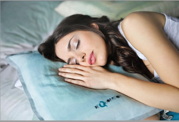 a-woman-with-white-shirt-sleeping-on-the-bed-1