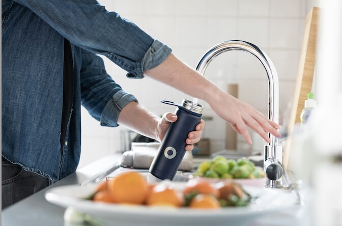 filling-up-water-from-the-water-tap-at-the-kitchen