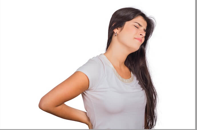 woman-having-issue-with-sacral-torsion-and-need-self-treatment