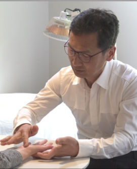 don-using-korean-hand-therapy-to-treat--his-patient-at-self-treatment-centre