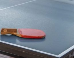 table-tennis-racket-on-the-blue-table
